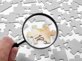 canadian dollar puzzle and magnifier, business concept